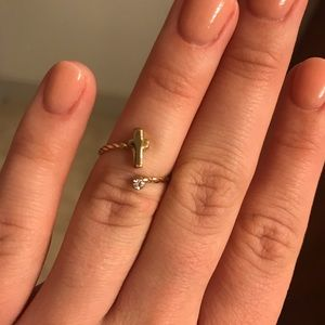 Gold cross with diamond knuckle ring